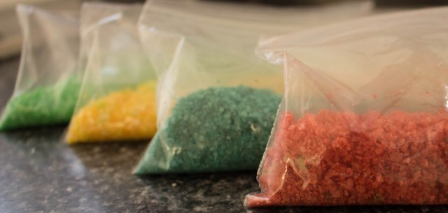 make DIY colorful birthday margarita salt by mixing food coloring