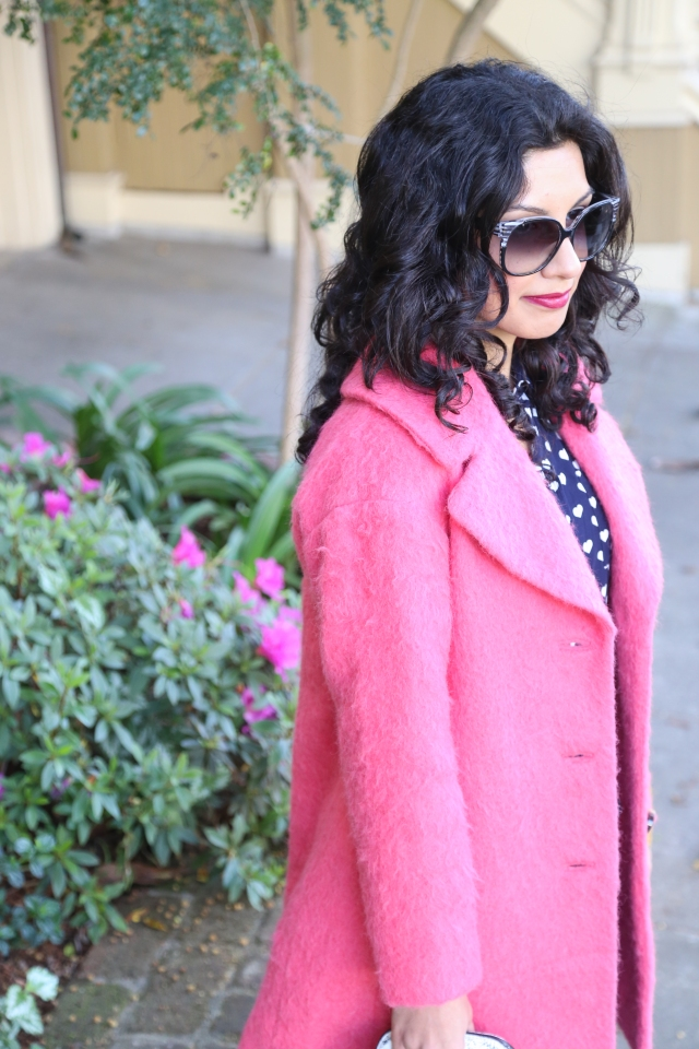 a pink coat and hearts