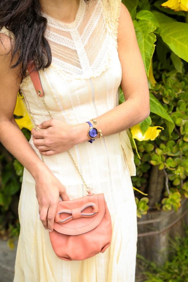 pink bow purse via beauty and sass